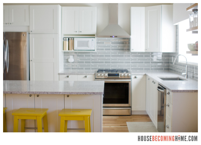 DIY Kitchen Renovation White Cabinets, Quartz Countertops, Yellow Stools