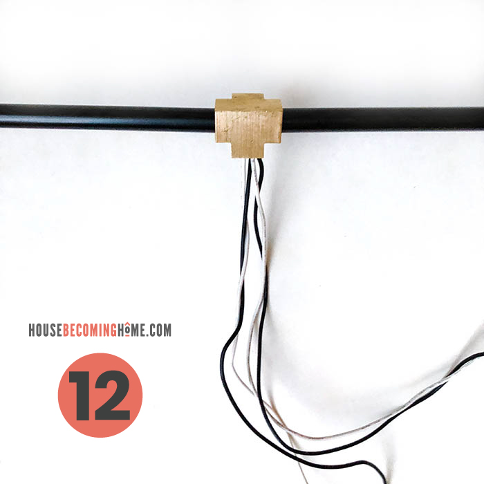 How to make a modern bathroom light fixture. Wires from light socket going through black pipe.