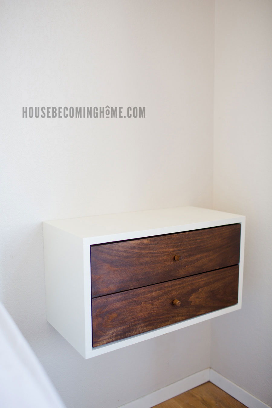 How to Build a Simple Floating Nightstand with Drawers. Includes free printable pdf plans.