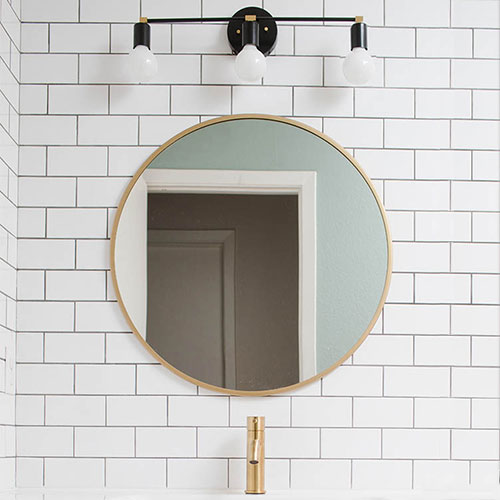 How to Make a Modern Bathroom Light Fixture : Black and Brass. A step by step tutorial with a complete supply list.