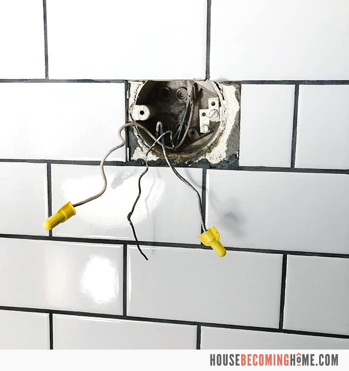 Replacing a bathroom light fixture. Black, white and copper wires in wall.