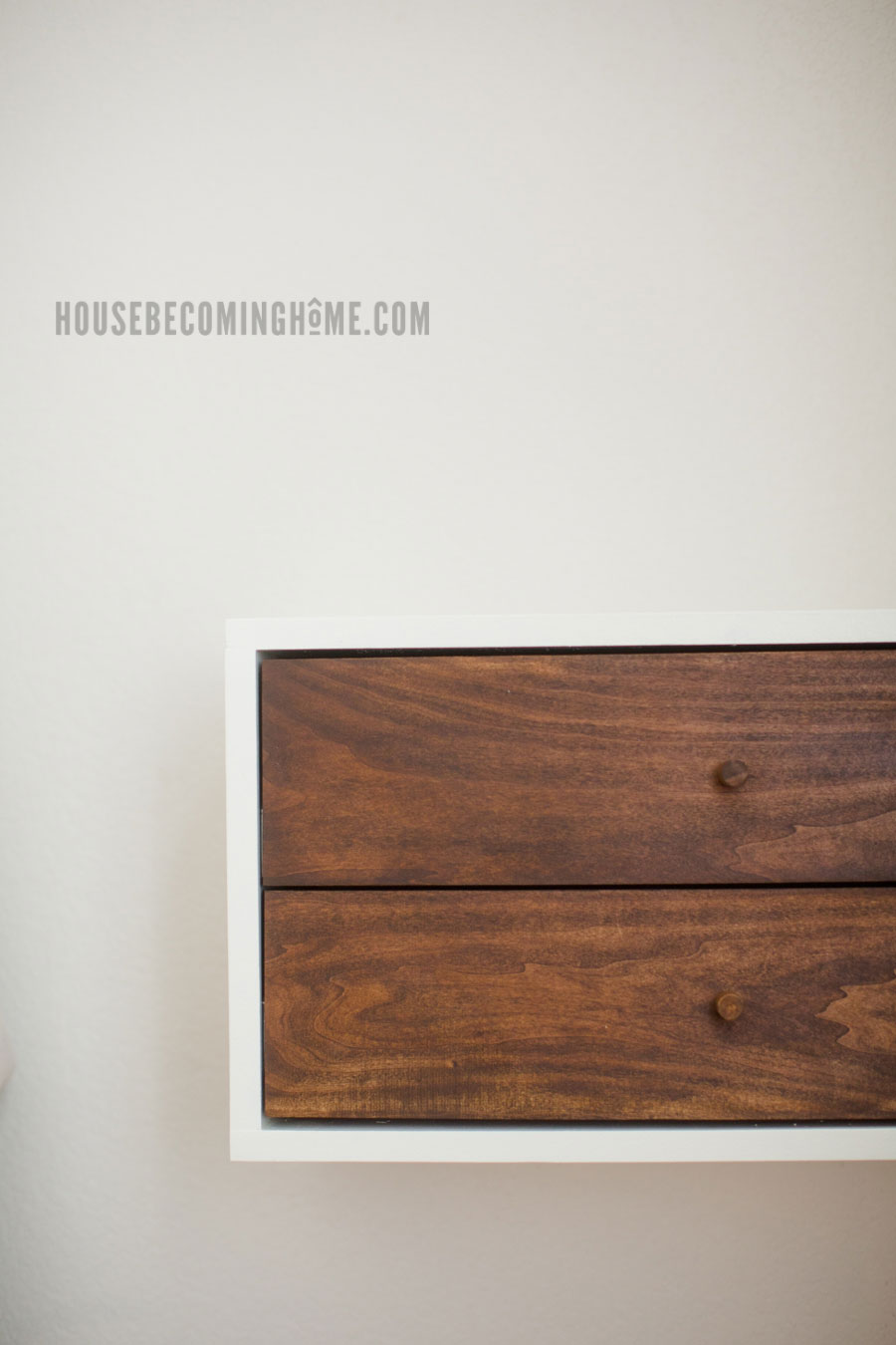 A simple, easy to build, modern DIY floating nightstand with two drawers