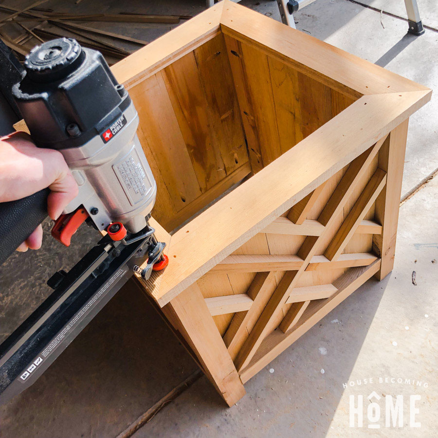 Nailing Down Mitered Top for DIY Cedar Planter with Decorative Panels