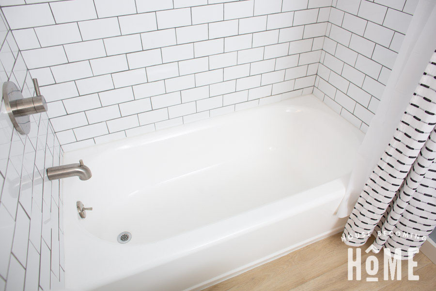 After painting an almond bathtub with white tub and tile refinishing kit