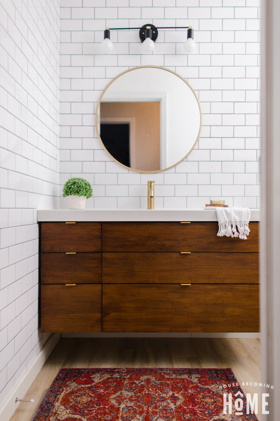 Small Bathroom Renovation After Shot on House Becoming Home : floating wood vanity, white subway tile, boho rug, black and brass light fixture