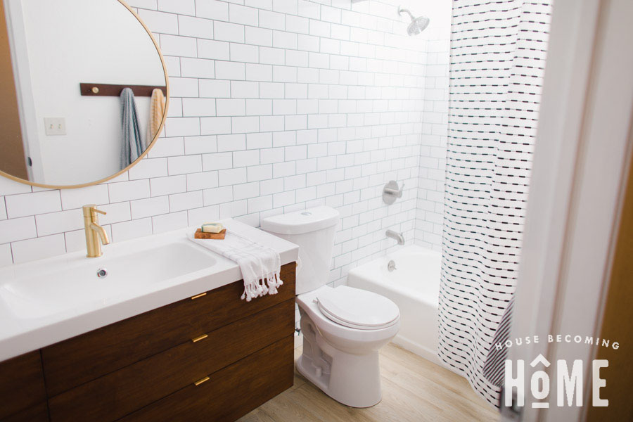 Small Bathroom Renovation After Shot on House Becoming Home : floating wood vanity, white subway tile, painted bathtub