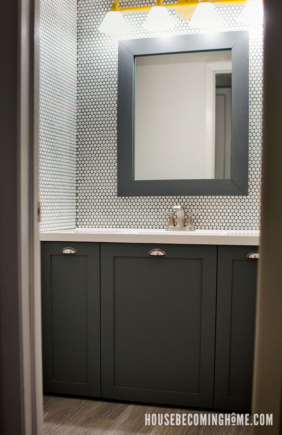 Bathroom with white penny tile wall
